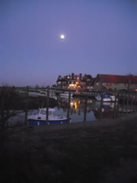a photo of moonlight over Blakeney Quay