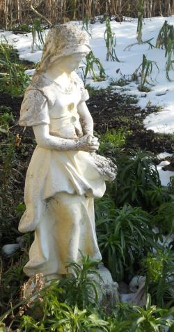a photo of a white statue that looks like Bernadette