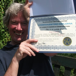 a photo of Greg holding his Diploma